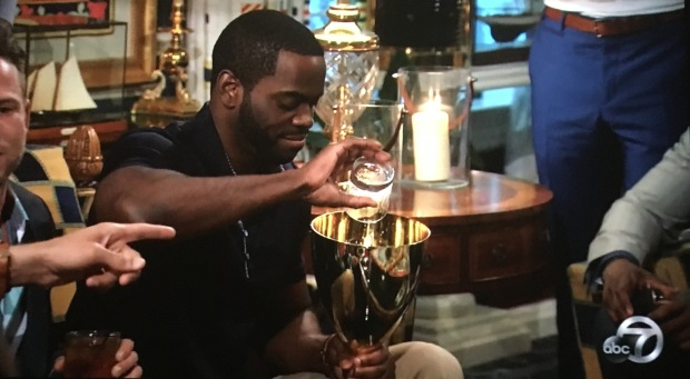 josiah pouring drink into his trophy.JPG